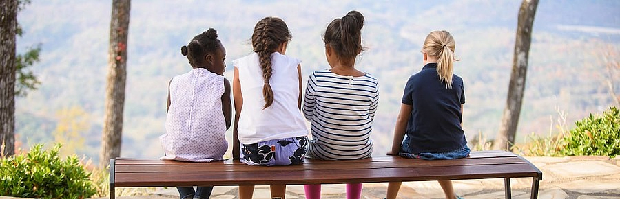 four-girls-sitting-bench
