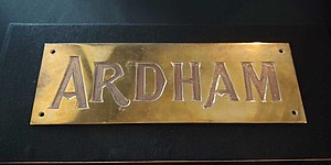 Ardham Technologies Gold Engraved Plate with Ardham logo
