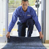 Man setting up cintas mat