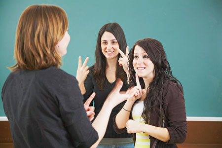 Group of three girls communicating in sign language