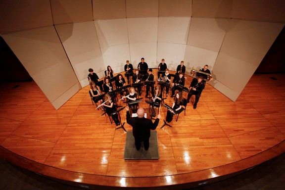 Aerial view of stage with small orchestra performing